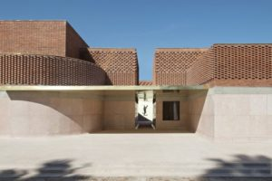 An exterior image of the entrance to the Yves Saint Laurent Museum in Marrakesh, Morocco