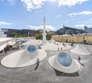 Blue and white modernist domed structures at the Amos Rex Museum in Helsinki