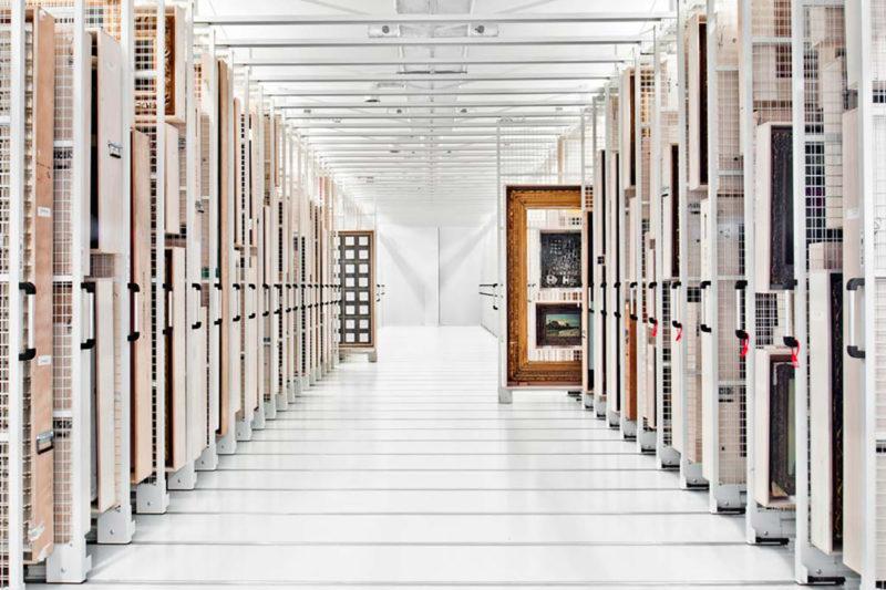 Rows of various paintings in storage racks