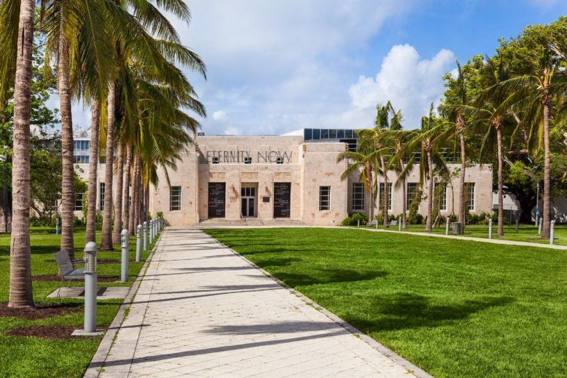 Exterior image of The Bass Museum of Art in Miami, FL with Pathway with Palm Trees