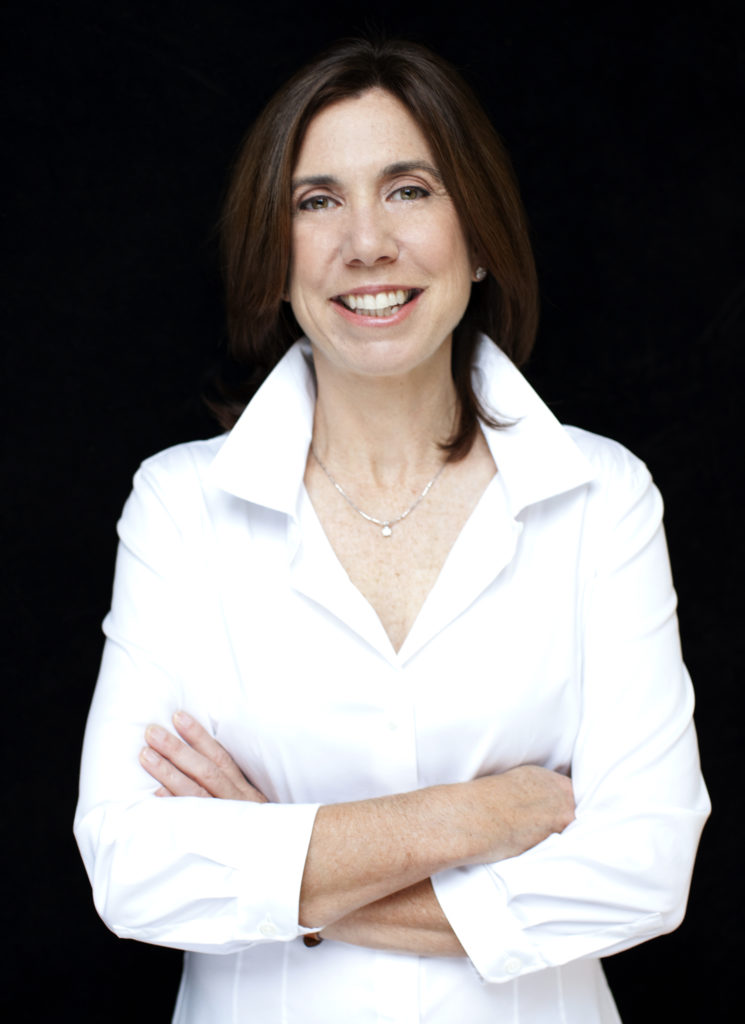 Barbara Prey headshot; a white woman with dark, medium length brown hair, wearing a white blouse with a popped collar