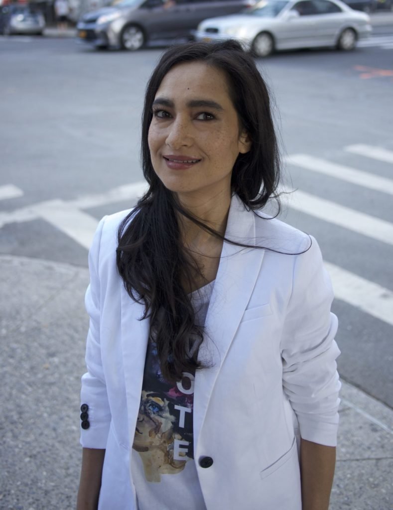Image of Shahzia Sikander, a Pakistani-American woman with long dark hair, wearing a white blazer