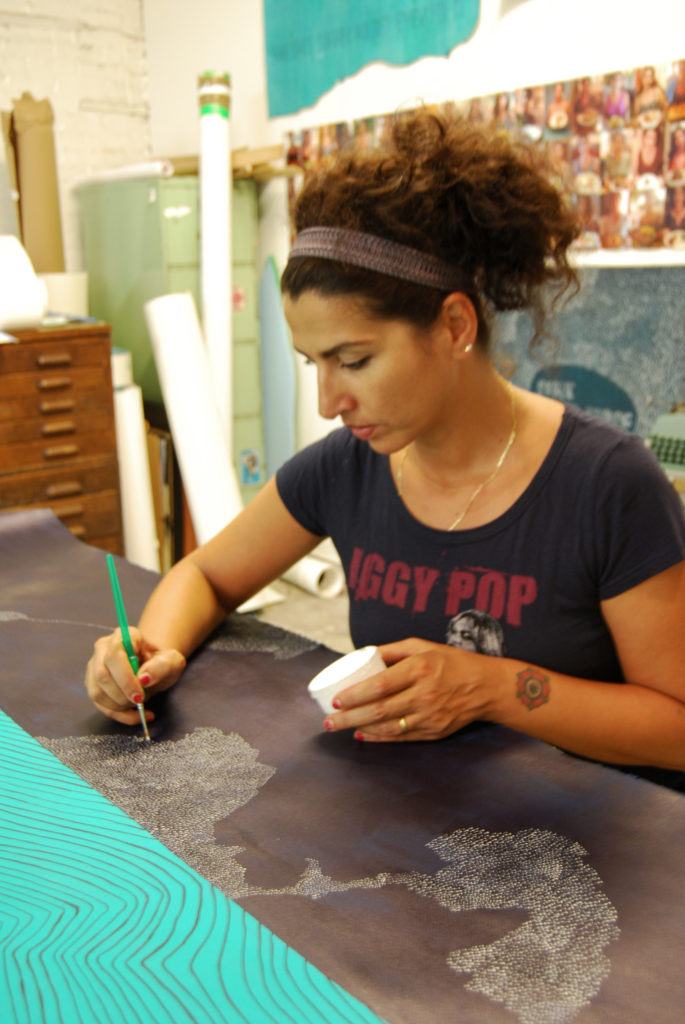 Dahlia Elsayed painting in her studio