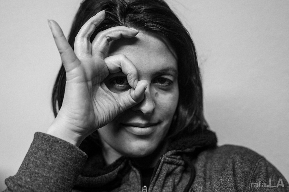 Sonia Romero making a circle with her fingers and looking through it