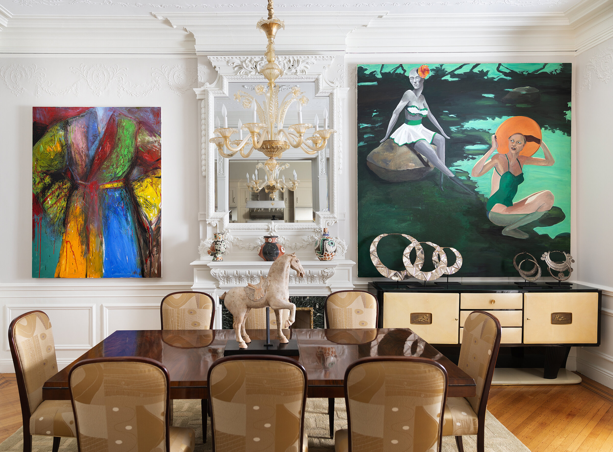 Interior, white walls with 2 paintings hanging parallel